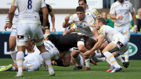 Wasps' Matt Mullan scores the game's first try against his old club Worcester