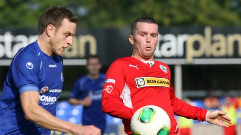 Michael McKerr and Martin Donnelly contend for the ball at Stangmore Park