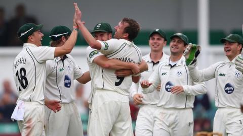 The Worcestershire team celebrate yet another Alan Richardson wicket