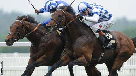 Al Kazeem on the right locked in battle with Mukhadram on the way to winning the Prince of Wales Stakes at Royal Ascot