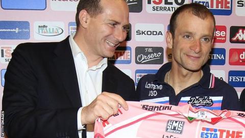 Giro d'Italia race director Michele Acquarone (left) poses with the 2011 race winner Michele Scarponi