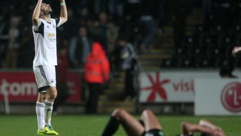Swansea City's Jordi Amat shows his relief at the final whistle of their 1-0 win over St Gallen at the Liberty Stadium