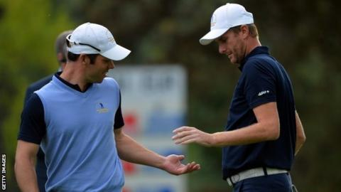 Paul Casey (left) and David Lynn of Great Britain and Ireland draw their side level
