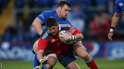 Munster's James Downey and Leinster's Cian Healy