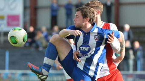 Coleraine striker Gary Browne finds himself closely marked by David Gibson of Ards