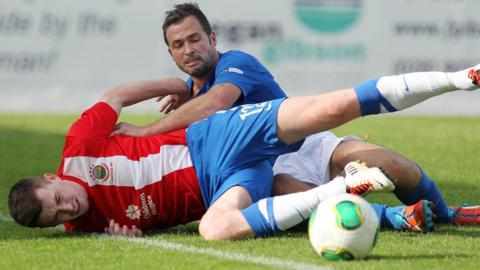 Linfield's Billy Joe Burns and David Rainey of Glenavon compete during the Irish Premiership match at Mourneview Park