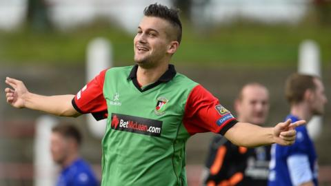 Mark Miskimmin celebrates after scoring Glentoran's second goal in their 2-1 Premiership victory over Dungannon Swifts