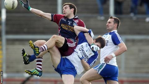 Ballinascreen's Brendan Heron beat Gareth McKinless of Ballinderry to a high ball