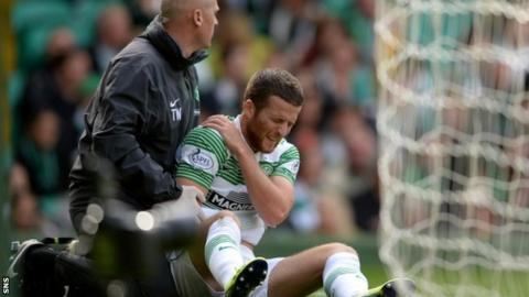 Adam Matthews in pain against Motherwell