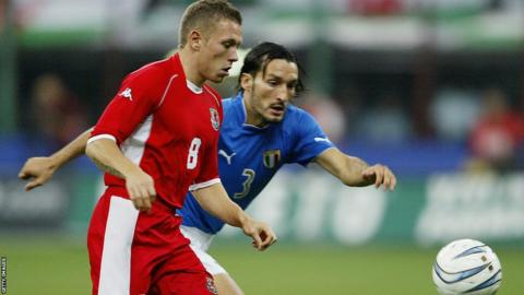 Bellamy battles with Italy's Gianluca Zambrotta during Wales' Euro 2004 qualifying defeat at the San Siro. Bellamy was sidelined as Wales' qualification hopes were ended by Russia in the play-offs