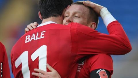 Craig Bellamy hugs Gareth Bale