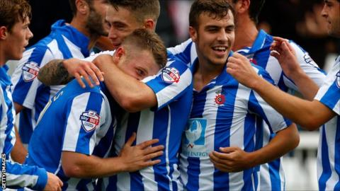 Hartlepool United players celebrate a goal against Accrington