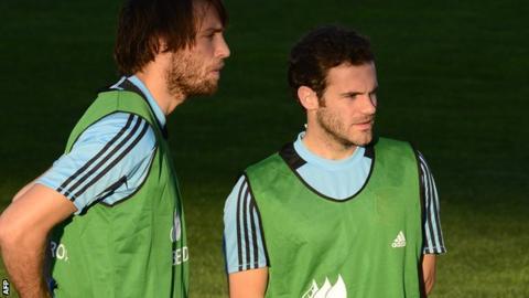 Michu (left) with Juan Mata