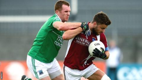 Marty McGrath tackles Westmeath's Paul Sharry