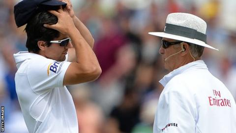Alastair Cook queries a DRS decision with umpire Tony Hill
