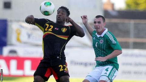 Northern Ireland's Luke McCullough is about to challenge Belgian goalscorer Michy Batshuayi