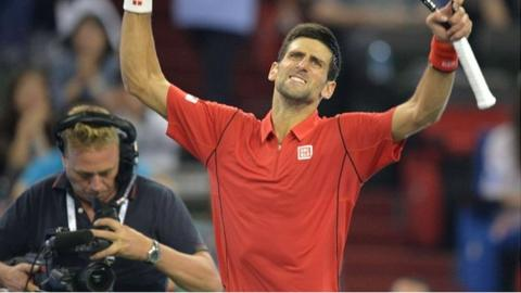 Novak Djokovic celebrates beating Gael Monfils
