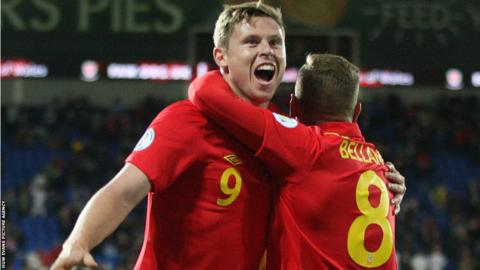 Craig Bellamy helps Simon Church celebrate the goal that gives Wales a 1-0 win