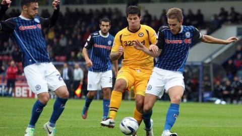 Newport's Danny Crow is outnumbered by the Rochdale defence