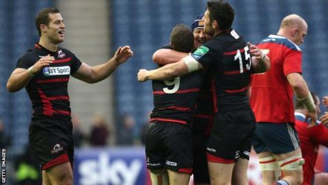 Edinburgh players celebrate the Heineken Cup win over Munster
