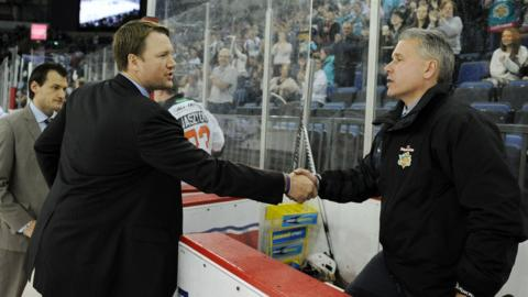 Sheffield Steelers coach Doug Christiansen and Paul Adey of the Belfast Giants shake hands prior to the Elite League match at the Odyssey