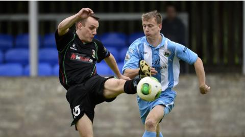 Jason Hill and Liam Bagnall contend for possession as Glentoran defeat Warrenpoint Town 1-0 at Stangmore Park