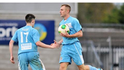 Johnny Taylor scored twice to earn Ballymena a 2-2 draw in their derby game against Coleraine