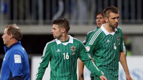 Northern Ireland players Oliver Norwood and Gareth McAuley trudge off the pitch after the 2-0 defeat by Azerbaijan