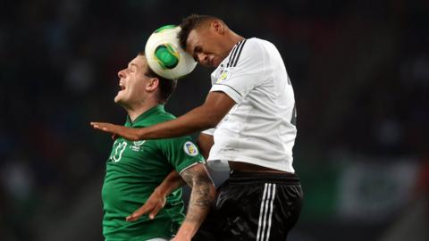 Anthony Stokes and Jerome Boateng in aerial action during the Republic of Ireland's 3-0 defeat by Germany