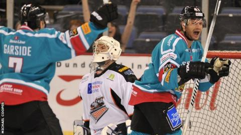 Adam Keefe of the Belfast Giants celebrates after scoring the third goal past Frank Doyle of the Sheffield Steelers during the 4-2 win in Elite League
