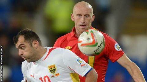 Goran Pandev of Macedonia and James Collins of Wales compete