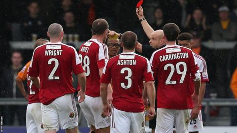 Barnet player manager Edgar Davids (fourth left) and Stephen Wright of Wrexham are both sent off by referee Nick Kinseley in their Conference Premier game