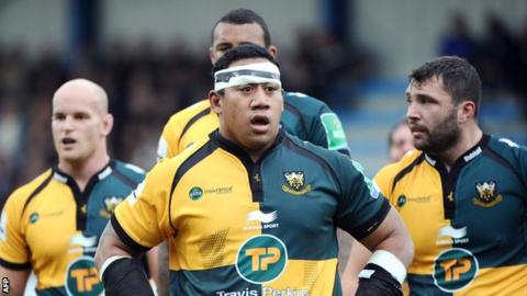Northampton Saints prop Salesi Ma'afu and team-mates gather against Castres