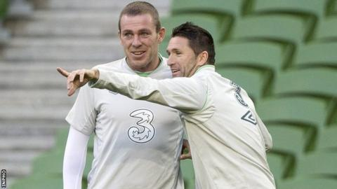 Robbie Keane talks to Richard Dunne during Republic of Ireland training on Monday
