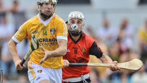 Neil McManus battles with Andy Savage in the 2010 Ulster Final