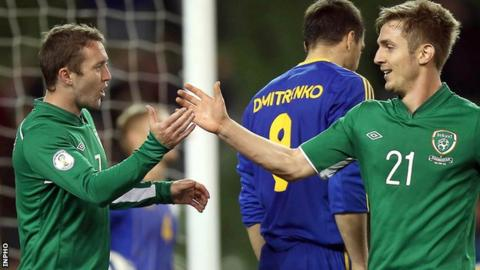 Aiden McGeady and Kevin Doyle celebrate the Republic's third goal