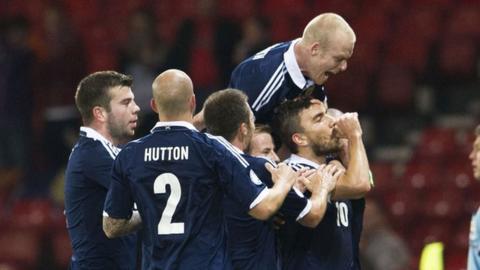 The Scotland players congratulate Robert Snodgrass on his goal