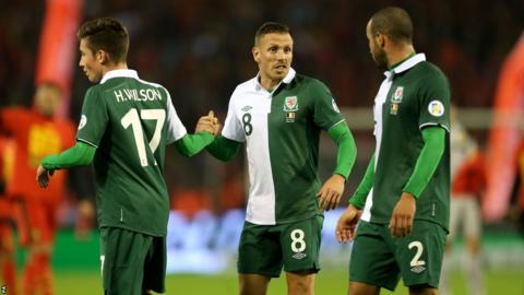 On Bellamy's final appearance, in the 1-1 draw against Belgium On Bellamy's final appearance, in the 1-1 draw against Belgium on 15 October 2013, the 34-year-old shakes the hand of the youngest player in Welsh history, Harry Wilson who was 16 years and 207 days old