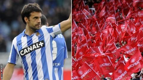 Xabi Prieto and Manchester United flags