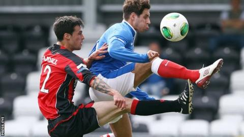Crusaders midfielder Declan Caddell challenges Sean ward of Linfield