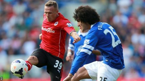 Craig Bellamy (left)