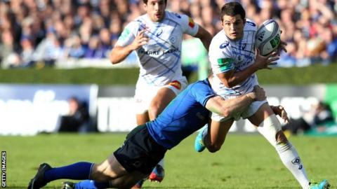 Leinster centre Gordon D'Arcy tackles Castres full-back Brice Dulin