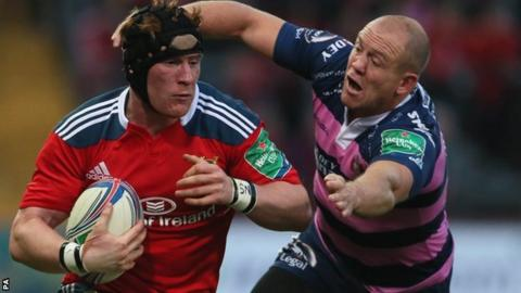Munster's Niall Ronan is tackled by Gloucester Mike Tindall