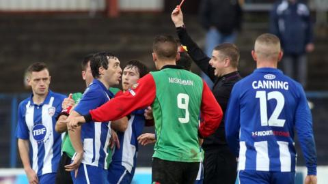 Coleraine defender Michael Hegarty is sent-off for a tackle on Jordan Stewart during the Premiership match which Glentoran won 3-1