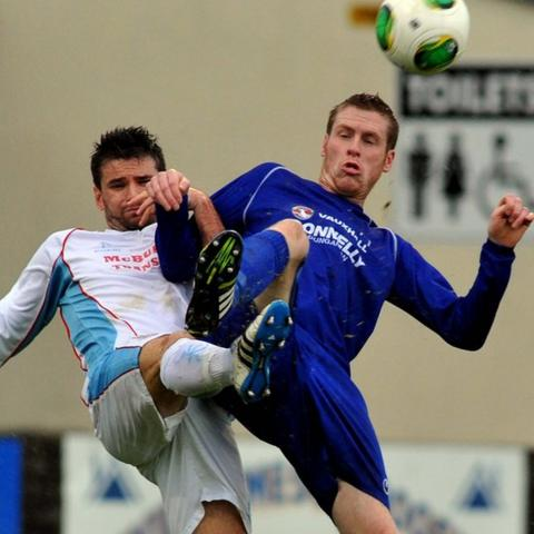 Mark McCullagh competes against Darren Boyce of Dungannon during Ballymena's 3-2 win at Stangmore Park