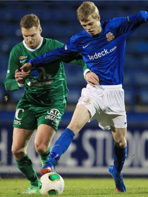 Cathal Beacom of Ballinamallard United in action against Glenavon's Rhys Marshall at Mourneview Park
