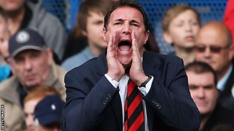Malky Mackay shouts instructions to his players from the touchline