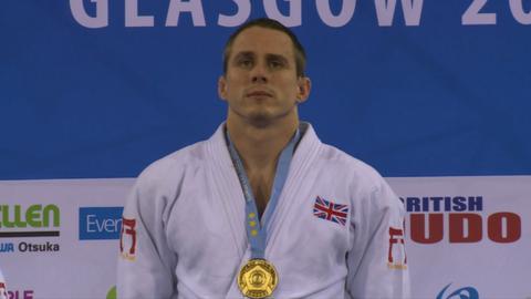 Euan Burton with gold medal on podium