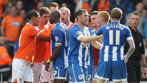 Wigan's James McClean is sent off against Blackpool