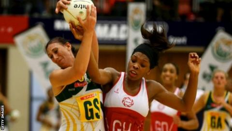 Chrisna Bootha of South Africa and Eboni Beckford-Chambers of England compete for the ball